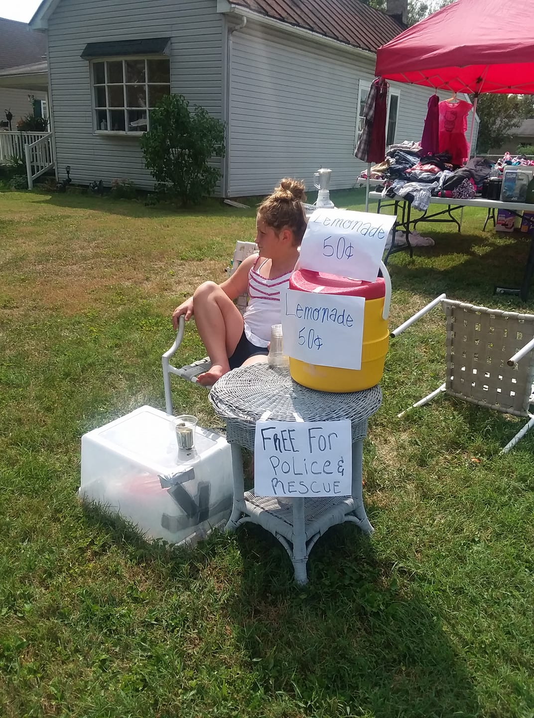 S Offer Free Lemonade To Firefighters And Police At Yard